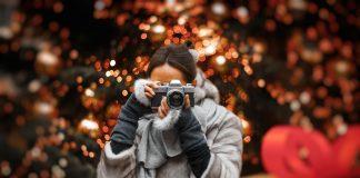 photo of woman taking photo 1734211